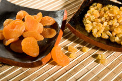 Dry apricot and sultana. Beautiful dry apricot and sultana in stone ware Royalty Free Stock Image