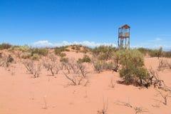 Dry arid red sand desert. On flat plain Royalty Free Stock Photography