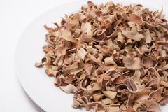 Dry Bael Fruit tea Aegle marmelos isolated on white background Stock Photo