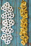 Dry banana chips and pretzels Stock Photos