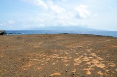 Dry, barren red dirt plateau on the islet of Djeu Stock Photo