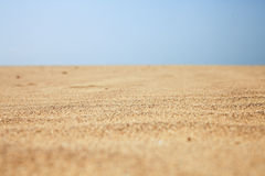 Dry beach sand and clear blue sky Royalty Free Stock Image
