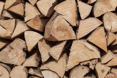 Dry beech wood ready for heating. Wooden logs stacked on top of each other. Stack of wood Royalty Free Stock Photos