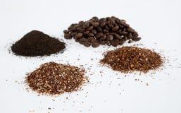 Dry beverages. Heaps of arabica coffee beans, green rooibos tea, rooibos tea, ceylon tea on white background Royalty Free Stock Images
