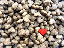Dry biscuits food for cat with heart shape. stock photography