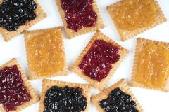 Dry biscuits. Some dry biscuits with jam on a white surface Stock Images