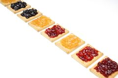 Dry biscuits. Some dry biscuits with jam on a white surface Stock Photos