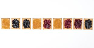 Dry biscuits. Some dry biscuits with jam on a white surface Royalty Free Stock Images