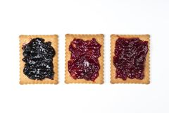 Dry biscuits. Some dry biscuits with jam on a white surface Stock Photo