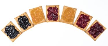 Dry biscuits. Some dry biscuits with jam on a white surface Royalty Free Stock Image