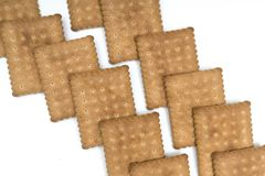 Dry biscuits. Some dry biscuits on a white surface Stock Photo
