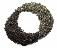Dry black and green tea on white background stock images