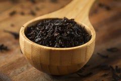 Dry Black Loose Leaf Tea Royalty Free Stock Photo