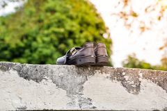 Dry black student shoes in the sun stock photography