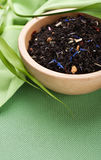 Dry black tea in bowl Stock Image