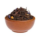 Dry black tea in a clay cup from above Stock Photos