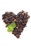Dry black tea heart shape Royalty Free Stock Images