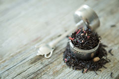 Dry black tea in infuser Stock Photography