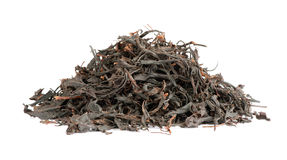 Dry black tea leaves Stock Photos
