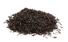 Dry black tea leaves isolated on a white Royalty Free Stock Images