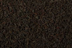 Dry black tea leaves texture background. Stock Image