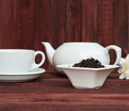 Dry black tea in a saucer Royalty Free Stock Photo