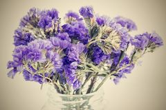 Dry bouquet small violet flowers with a retro effect Royalty Free Stock Photo