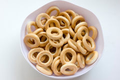 Dry bread-ring, sooshka, small ring-shaped cracker. Baranka, bagel, bowl, baking, yellow, candy, small ring-shaped crackerdry bread-ring, sooshka, small ring Stock Photography