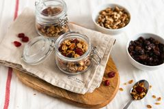 Dry breakfast cereals. Crunchy honey granola bowl with flax seeds, cranberries and coconut. Healthy and fiber food. Breakfast time royalty free stock photos