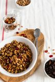 Dry breakfast cereals. Crunchy honey granola bowl with flax seeds, cranberries and coconut. Healthy, vegeterian fiber food. royalty free stock image