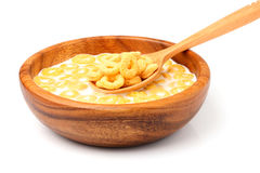 Dry Breakfast with milk in a wooden bowl with a spoon. Stock Images