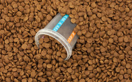 Dry brown pet food (dog or cat) with measure glass Royalty Free Stock Photo