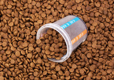 Dry brown pet food with measure glass Royalty Free Stock Photo