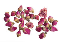 Dry buds of rose flower for tea. On white stock photography