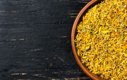 Dry calendula in bowl Stock Images