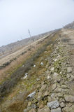 Dry canal for irrigation. Royalty Free Stock Photos