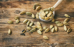 Dry cardamom grains in wooden spoon Royalty Free Stock Photos
