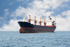 Dry cargo ship floating on the sea Royalty Free Stock Photos