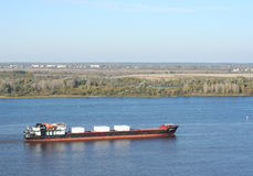 Dry-cargo ship loaded floats down the Volga river Stock Images