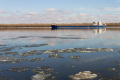 Dry cargo ship on the winter river. Astrakhan stock image