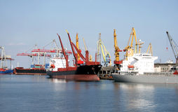 Dry-cargo ships cost at moorings Stock Images