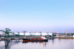 Dry cargo vessel and bunkers at Marina in Ventspils at sunset Royalty Free Stock Image