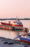Dry cargo vessel at the Marina in Ventspils at sunset Royalty Free Stock Image