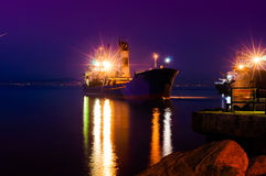 Dry Cargo Vessel On Riprap Works Royalty Free Stock Photos