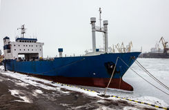 Dry cargo vessel in sea port Stock Images