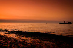 Dry Cargo Vessel On On The Sunset Royalty Free Stock Image