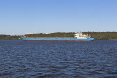 Dry-cargo vessel Volgo-Don 5056 passes through the Sheksna River in Vologda Region Royalty Free Stock Images