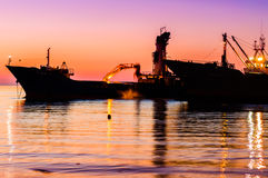 Dry Cargo Vessels On Riprap Works Stock Photography