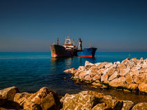 Dry Cargo Vessels On Riprap Works Royalty Free Stock Photos
