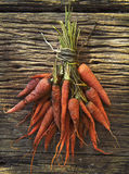 Dry carrot lyinng on old top wood table Royalty Free Stock Photos